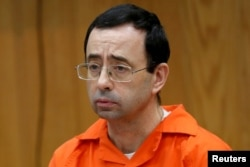 FILE PHOTO: Larry Nassar, a former team USA Gymnastics doctor who pleaded guilty in November 2017 to sexual assault, listens to victims impact statements during his sentencing in the Eaton County Circuit Court in Charlotte, Michigan, Jan. 31, 2018.