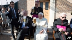 From left, Bavarian Prime Minister Horst Seehofer, Monsignor Georg Gaenswein, Pope Emeritus Benedict XVI and his brother, Georg, sit on the occasion of a party for Benedict's 90th birthday at the Vatican, April 17, 2017.