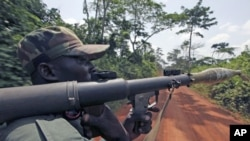 A pro-Outtara soldier belonging to the Republican Forces of Ivory Coast holds a rocket-propelled grenade launcher during a patrol in Fengolo, a looted village in Duekoue town, May 19, 2011 (file photo)