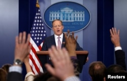 FILE - White House spokesman Sean Spicer holds a press briefing at the White House in Washington, D.C., Jan. 23, 2017.