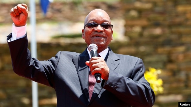 FILE - South Africa's President Jacob Zuma addresses the media after unveiling a bronze statue of the late former President Nelson Mandela as part of the Day of Reconciliation Celebrations at the Union Buildings in Pretoria, Dec. 16, 2013.