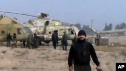 Şam yakınlarındaki hava üssünü ele geçiren isyancıları gösteren video