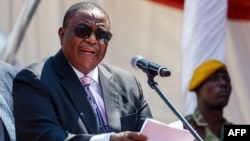 Zimbabwe's Vice-President Constantino Chiwenga speaks during the Defence Forces Day celebrations held at the National Sports Stadium in Harare on August 14, 2018. (Photo by Jekesai NJIKIZANA / AFP)