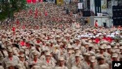Este grupo armado al que se incorporan civiles fue creado por Hugo Chávez y es una rama de las Fuerzas Armadas del país. La celebración ocurre en medio de una creciente tensión y protestas en el país desde finales de marzo.