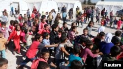 Syrian refugee children play at a makeshift school, supported by UNICEF and in cooperation with the Beyond Association, in Zahle in the Bekaa valley.