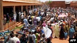 Malians stand in line to vote at a polling station set up in the Sabalibougoui school in Bamako during the presidential election in Mali on July 28, 2013.