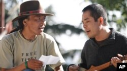The filmmaker, Ngawang Choephel (right) and a friend, prepare a traditional song for 'Tibet in Song.'