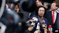 FILE - Thida Thavornseth, a senior member of the United Front for Democracy against Dictatorship (UDD) or Red Shirts, talks to reporters as she leaves the Bangkok South Criminal Court in Bangkok, Thailand, April 30, 2015.
