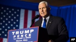 FILE - Republican Vice President-elect Mike Pence speaks during a campaign rally in Mason, Ohio.