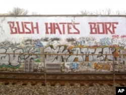 A tagger who called himself Borf gave Cool Disco Dan a run in the mid-2000s. Someone - likely not Borf since the style looked different - changed Bush to Obama recently.