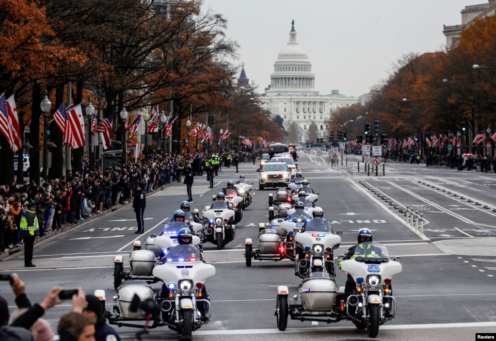 The funeral procession carrying the body of former U.S. President George H. W. Bush passes down Pennsylvania Avenue in Washington, Dec. 5, 2018.
