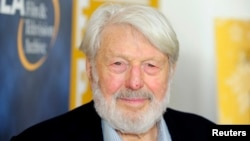 "FILE - Actor Theodore Bikel arrives at the opening night of the UCLA Film and Television Archive film series ""Champion: The Stanley Kramer Centennial"" and the world premiere screening of the newly restored ""Death of a Salesman"" in Los Angeles, California, Aug. 9, 2013."