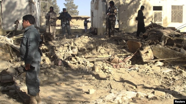 Afghan forces inspect at the site of suicide attack in Spin Boldak district of Kandahar province January 6, 2013.