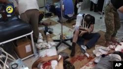 2016年9月24日阿勒頗轟炸後接受治療、受傷的民眾