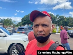 Unemployed 42-year-old Quinton Hassen, shown here in Harare, Zimbabwe, Feb. 18, 2021, says he can't wait to be vaccinated against COVID-19. He has to wait as the country imports vaccines. (Columbus Mavhunga/VOA)