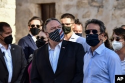 US Secretary of State Mike Pompeo, left, and Greek Prime Minister Kyriakos Mitsotakis visit the archeological site of Aptera, on the Greek island of Crete, Sept. 29, 2020.