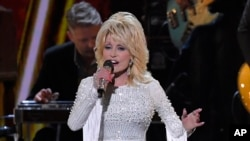 FILE - This Nov. 13, 2019 file photo shows Dolly Parton performing at the 53rd annual CMA Awards in Nashville, Tenn. Parton tweeted Wednesday, April 1, that she's donating $1 million to Vanderbilt University Medical Center in Nashville, Tennessee.