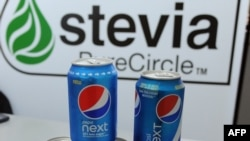 FILE - Cans with soft drinks partially sweetened with stevia, produced by PureCircle, are seen in an Oct. 31, 2014, illustration photo.