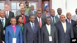 Uganda VP Edward Sekandi, second left, front row, Uganda PM Ruhakana Rugunda, right, and East African Community Secretary-General Dr. Sezibwera, second right, pose with others, during Burundi peace talks, at Entebbe State House, Dec. 28, 2015.