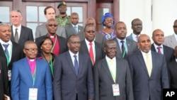 Uganda VP Edward Sekandi, second left, front row, Uganda PM Ruhakana Rugunda, right, and East African Community Secretary-General Dr. Sezibwera, second right, pose with others, during Burundi peace talks, at Entebbe State House, Dec. 28, 2015.
