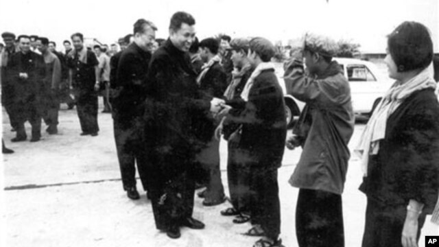In this undated photo provided by Documentation Center of Cambodia, the late Khmer Rouge leader Pol Pot, center, greets Khmer Rouge cadre in Phnom Penh airport, Cambodia.