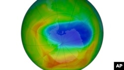 This image made available by NASA shows a map of a hole in the ozone layer over Antarctica on Sunday, Oct. 20, 2019. The purple and blue colors indicate the least amount of ozone, and the yellows and reds show the most.
