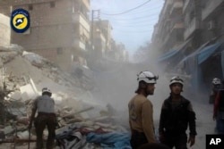 "Aleppo"" In this picture provided by the Syrian Civil Defense group known as the White Helmets, Syrian Civil Defense workers search through the rubble in rebel-held eastern Aleppo, Syria, Wednesday, Oct. 12, 2016."