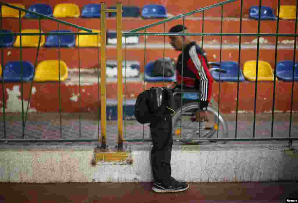 A disabled Palestinian passes by an artificial limb before the start of a local wheelchair basketball championship in Gaza City.
