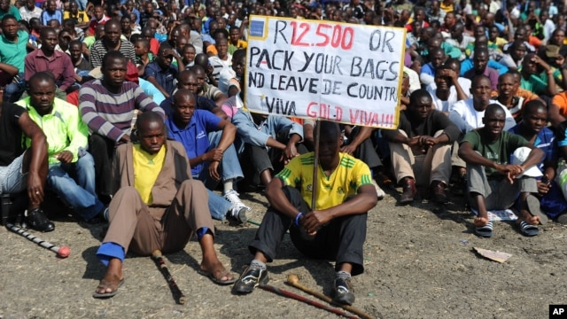 Striking Lonmin Platinum miners gather in Marikana, South Africa, where a new wage offer was rejected, Sept. 14, 2012.