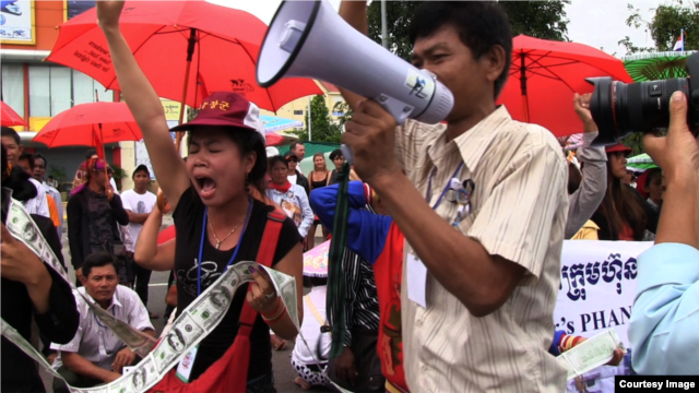 FILE - People rally to raise awareness of human rights abuses in Cambodia in 2012.