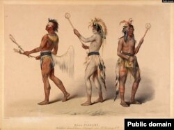 """The Ball Players,"" painting by 19th century artist George Catlin, depicts Choctaw, Sioux, and Ojibwe stickball players."