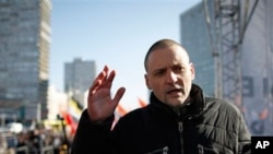 Opposition leader Sergei Udaltsov speaks during an opposition rally in Moscow, Russia, Saturday, March 10, 2012.