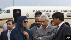Pakistan's newly installed FM Hina Rabbani Khar, second left is received by India`s high Commissioner to Pakistan Sharat Sabharwal, right, as Pakistan's high commissioner to India Shahid Malik, second right, looks on at the airport in New Delhi, India, Ju