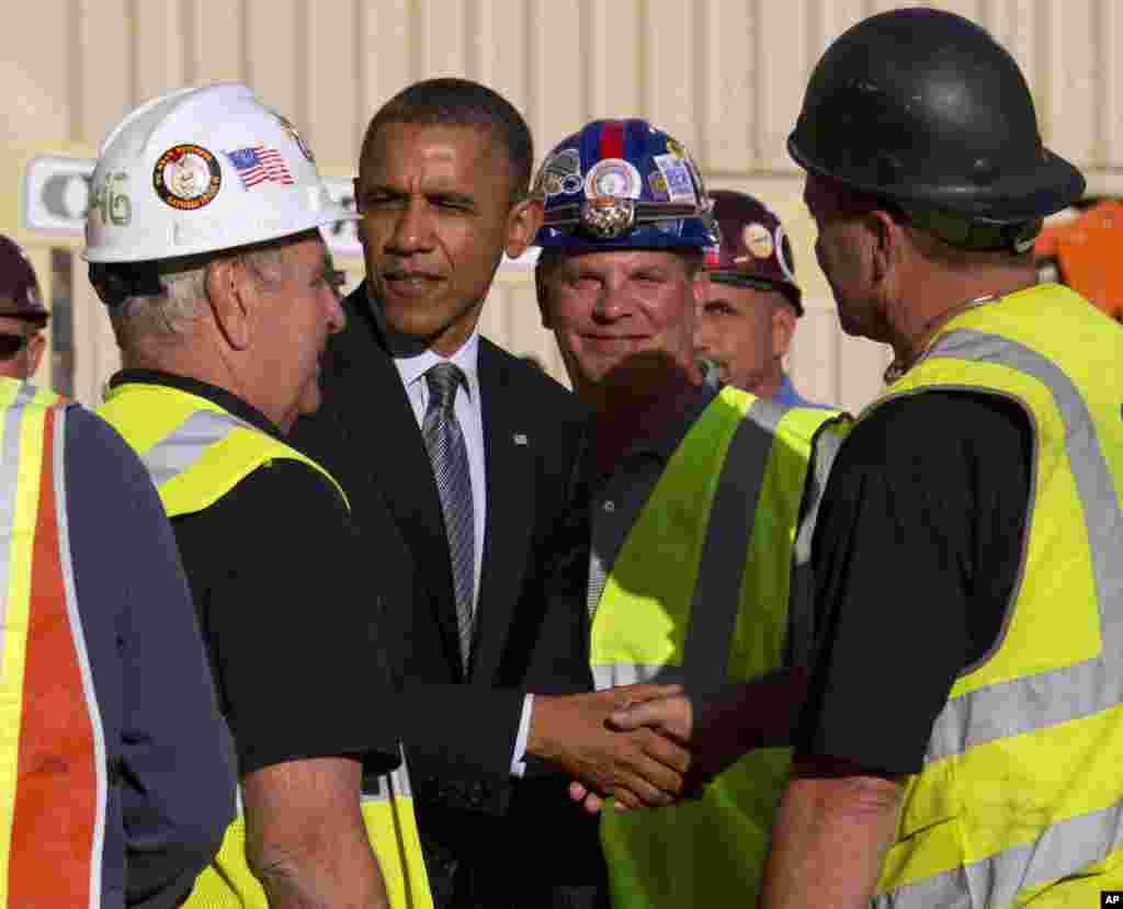 President Barack Obama greets workers at the Port Authority of New York and New Jersey's World Trade Center site, June 14, 2012, in New York.