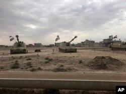 Iraqi tanks deploy in the village of Bashir, south of Kirkuk, Iraq, Oct. 13, 2017.