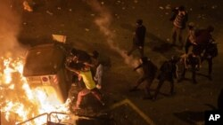 Protesters barricade during clashes with police in Barcelona. (AP)