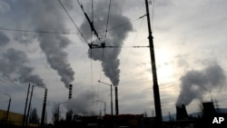 FILE - The Druzhba power plant pumps out smoke as it works at full power in the Bulgarian capital of Sofia, Jan. 24, 2006.