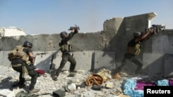 ກຳລັງພິເສດຂອງອີຣັກ ພວມສູ້ລົບກັບກຸ່ມ ISIL ທີ່ເມືອງ Ramadi (19 ມິຖຸນາ 2014)