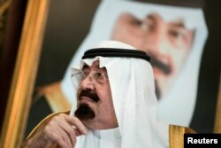 FILE - Saudi King Abdullah bin Abdul Aziz al-Saud sits before a meeting with U.S. Secretary of State John Kerry at the Royal Palace, Jeddah, Sept. 11, 2014.