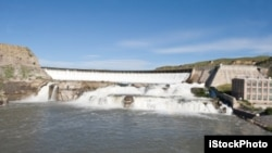 Many dams help control the flow of the Missouri River. This one is in Montana.