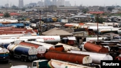 FILE - Trucks are seen parked around an automobile workshop overlooking Lagos. A recent strike by truck drivers is crippling trade between Nigeria and Cameroon.