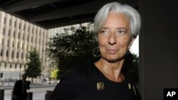 France's Minister of Economy Christine Lagarde arrives for a day of meetings ahead of her interview to potentially be the next managing director of the International Monetary Fund, at IMF headquarters in Washington, June 22, 2011.