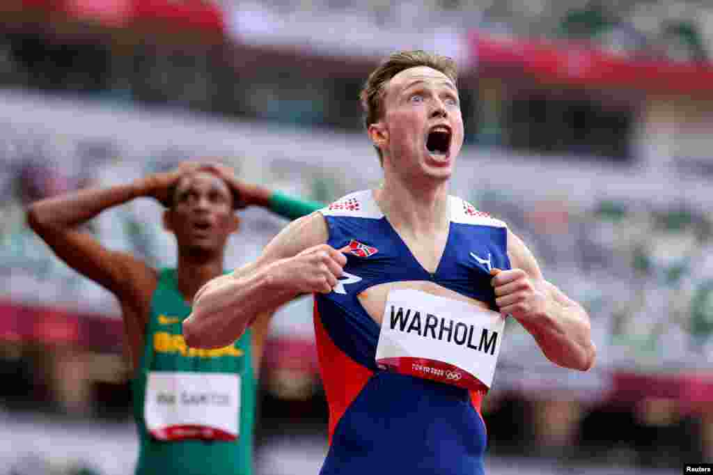 Karsten Warholm of Norway celebrates as he wins the gold medal in the final of the men's 400-meter hurdles at the 2020 Summer Olympics in Tokyo, Japan.