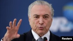 Brazil's President Michel Temer gestures during the launch of the new financing line of Bank Caixa Economica Federal at the Planalto Palace in Brasilia, Brazil, Nov. 24, 2016.