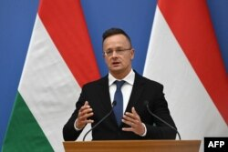 FILE - Hungarian Foreign and Trade Minister Peter Sizzarto addresses a press conference in Budapest on September 10, 2021,