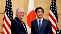 Rex Tillerson and Shinzo Abe.
