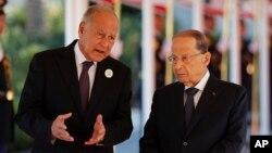 Arab League Secretary-General, Ahmed Aboul Gheit, left, speaks with Lebanese President Michel Aoun, right, at Rafik Hariri international airport in Beirut, Lebanon, Jan. 20, 2019.