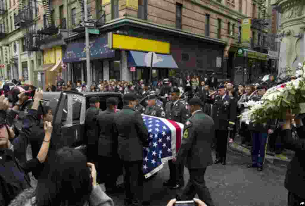 Pvt. Danny Chen's casket is carried into a hearse by soldiers during his funeral procession on Thursday, Oct. 13, 2011 in New York. (AP Photo/Jin Lee)