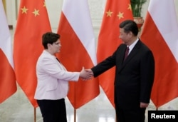 Poland's Prime Minister Beata Szydlo, left, meets China's President Xi Jinping ahead of the upcoming Belt and Road Forum at the Great Hall of the People in Beijing, May 12, 2017.