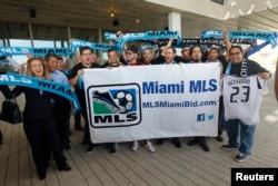 Supporters of an MLS expansion team to Miami cheer as they wait for David Beckham's arrival to a news conference in Miami, Florida, Feb. 5, 2014